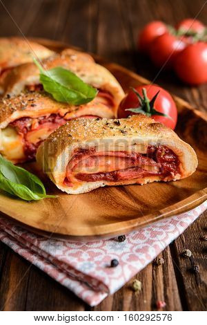 Stromboli Stuffed With Cheese, Salami, Green Onion And Tomato Sauce