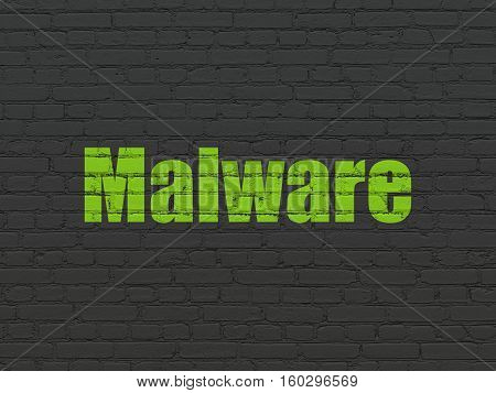 Privacy concept: Painted green text Malware on Black Brick wall background