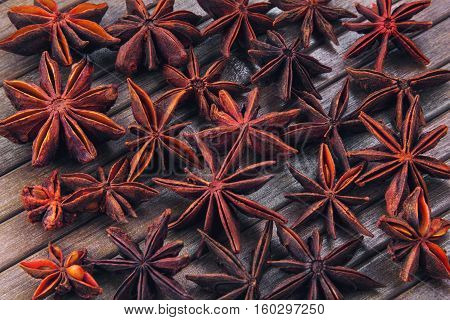 star anise on a wooden striped background