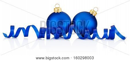 Two Blue Christmas baubles and curling paper Isolated on white background