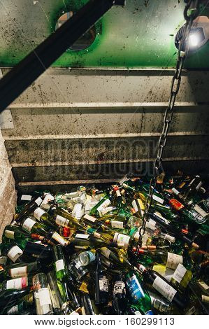 PARIS FRANCE - NOV 29 2016: Interior view of a garbage glass recycle container with multiple glasses from beer food wine juice cola and other glass recycling for a good environmental protection