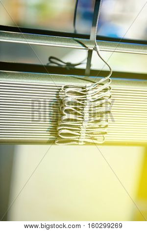 Window blind clos-up detail - construction decoration new home on asunny day with sunny flare