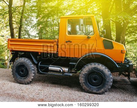 FRANCE - MAY 10 2015: Powerful Unimog four wheel drive vehicle as seen on a forest road. Unimog is a range of multi-purpose auto four-wheel drive medium trucks produced by Mercedes-Benz a division of Daimler AG.