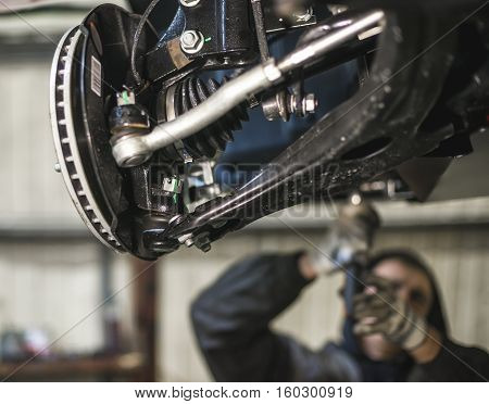 car suspension parts with shallow depth of field and unrecognizable working behind