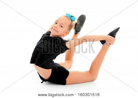 Little flexible gymnast doing exercise isolated on white