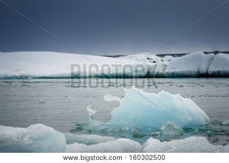 Photo of blue frozen icebergs at glacial lagoon