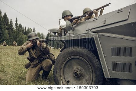 PERM RUSSIA - JULY 30 2016: Historical reenactment of World War II summer 1942. Soviet soldiers with rifles
