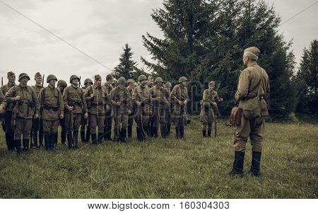 PERM RUSSIA - JULY 30 2016: Historical reenactment of World War II summer 1942. Soviet officer in front of the line of soldiers