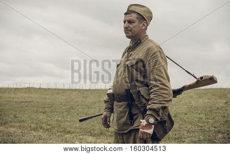 PERM RUSSIA - JULY 30 2016: Historical reenactment of World War II summer 1942. Soviet soldier with machine gun