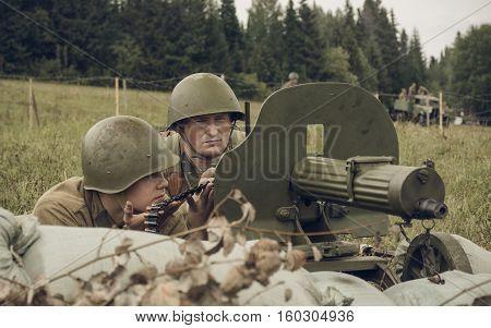 PERM RUSSIA - JULY 30 2016: Historical reenactment of World War II summer 1942. Soviet soldiers witn machine gun