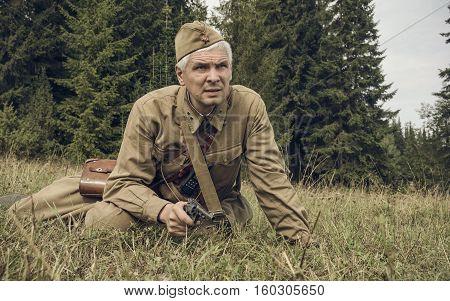 PERM RUSSIA - JULY 30 2016: Historical reenactment of World War II summer 1942. Soviet officer with pistol