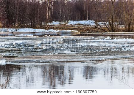 Early spring, the ice drift on the river. Ice floating in the river.