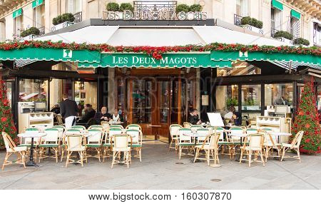 Paris France-December 05 2016: The famous cafe Les deux magots decorated for Christmas located on Saint-Germain boulevard in Paris.It was once home for to intellectual stars from Hemingway to Picasso.