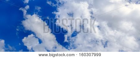 background of blue sky with large clouds. Panorama of heaven. The meteorological view of the atmosphere. Weather cloud scene.