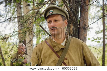 TAVATUI SVERDLOVSK OBLAST RUSSIA - AUGUST 20 2016: Historical reenactment of Russian Civil war in the Urals in 1918. Soldier of White Army