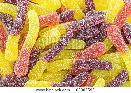 a lot of colorful fruit sugar gummy confectionery