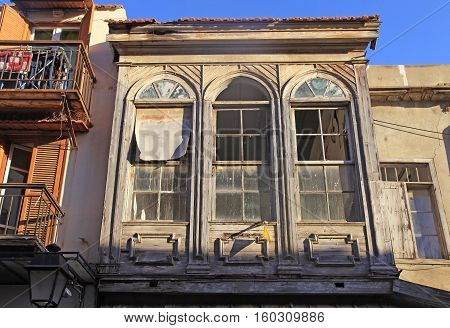 Old house with wood broken windows, Greece