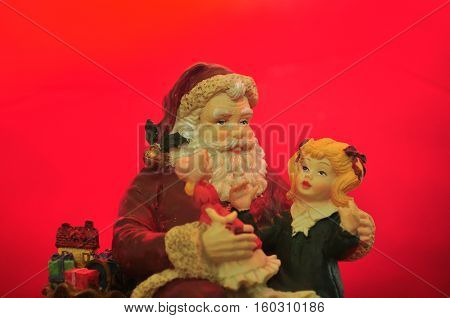 SANTA ASKING A LITTLE GIRL WHAT SHE WANTS FOR CHRISTMAS