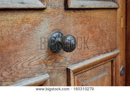Vintage handle on the wood door in Birmingham