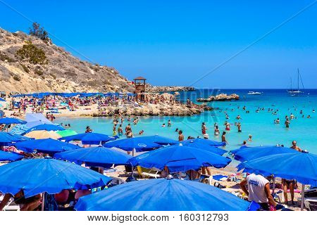 PROTARAS CYPRUS - AUGUST 18 2016: People relaxing and sunbathing at Konnos beach