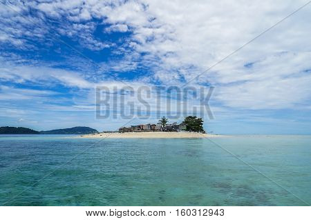 Small island in Gusungan island with sandy beach in Semporna,Sabah.Its a sea gypsy or Bajau Laut village,they are the sea gypsies who live in the open sea.