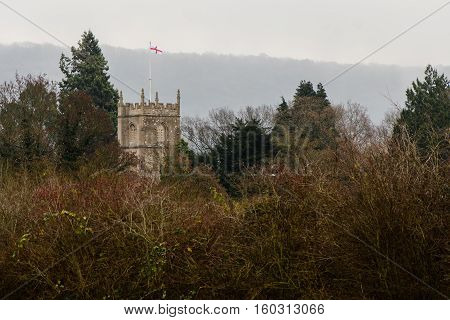 George cross flag above Bathampton, St. Nicholas church. Parish church a few miles from the city of Bath in Somerset UK