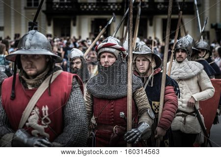 PRAGUE CZECH REPUBLIC - SEPTEMBER 04 2016: Armored knights lead the march at Celebration of the 700th anniversary of King Charles IV's coronation.