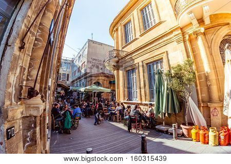 NICOSIA - APRIL 13 2015: People at restaurants and traditional coffee shops on Ledra street