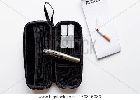 elimination of tobacco smoking electronic cigarette on white background top view