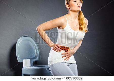 Woman Suffer From Belly Pain Holds Pills In Toilet