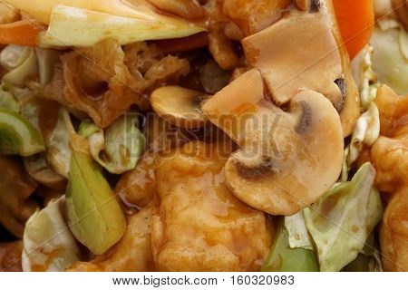 Chinese dish. Chinese food. Fish with vegetables. Closeup.