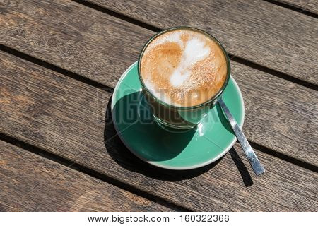 closeup of caffe latte on wooden table