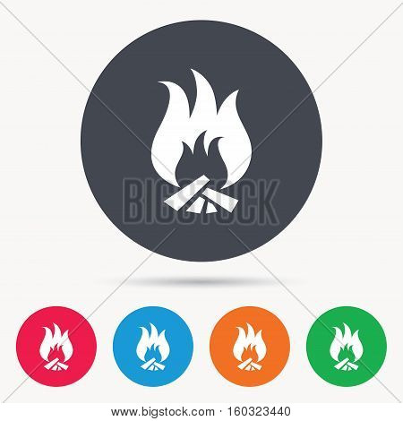 Fire icon. Blazing bonfire flame symbol. Colored circle buttons with flat web icon. Vector