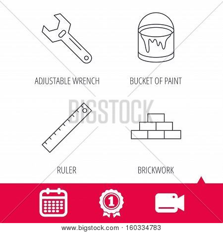 Achievement and video cam signs. Brickwork, measurement and adjustable wrench icons. Bucket of paint linear sign. Calendar icon. Vector