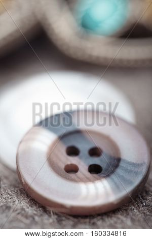 Buttons on a woolen fiber. Extremely macro photo with shallow depth of field