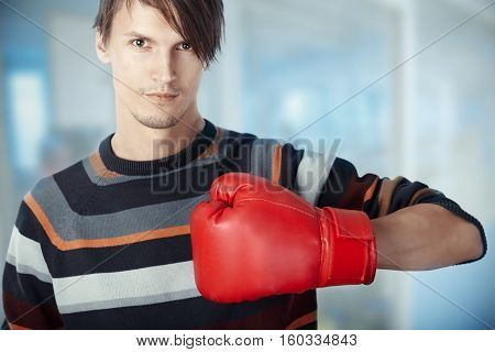 Man at the office with boxing glove. Horizontal photo