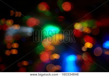 Abstract background with colorful spheres of defocused illumination