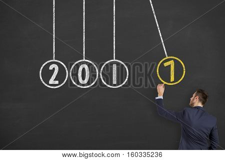 Innovation Concepts Newtons Cradle New Years on Chalkboard