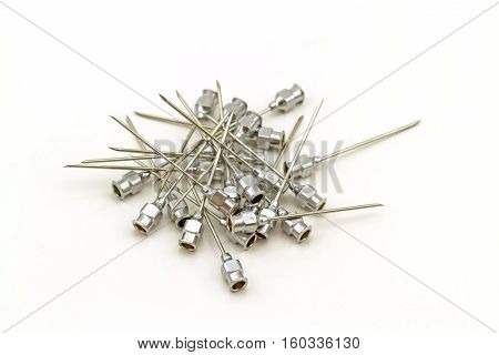 Stack of reuse iron needle No.18 G for drug needle on white background