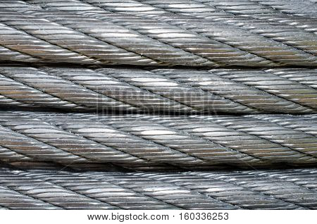 Electrical metal wire cord.  Up close view of coiled wire material.  Construction electric equipment to transfer power and energy.