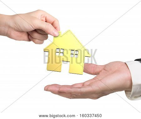One Hand Giving Golden House To Another Hand