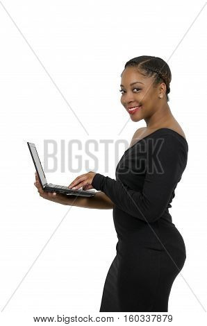 Beautiful computer savvy young black woman using a laptop