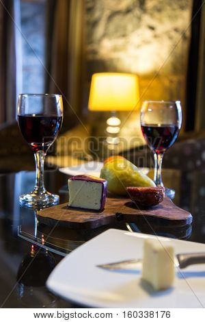 warm and cozy on a winter day with an appetizer of wine and cheese for two