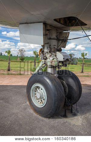 close up of big airplane wheels and landing gear