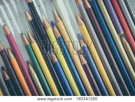 Old multicolor pencil in box with vintage effect
