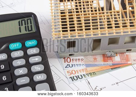 House Under Construction, Calculator And Currencies Euro On Electrical Drawings, Concept Of Building