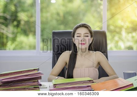 A beautiful young woman with a busy job,young woman working a lot document,the work of a busy girl.