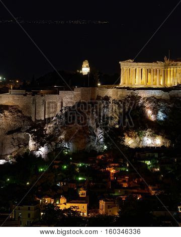 Partehnon on Acropolis hill and Plaka old neighborhood night view Athnes Greece