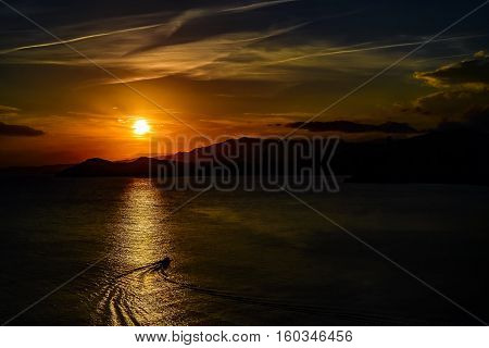 boat on the background of an amazing sunset