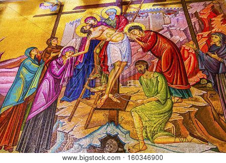 JERUSALEM, ISRAEL - NOVEMBER 18, 2016 Chirst Taken Down from Cross Mary Joseph of Airmetihia Mosaic Church of the Holy Sepulchre Jerusalem Israel. Church expanded in 1114 to 1170 AD contains Jesus Tomb and Golgotha Crucifixion site. Church site of resurre